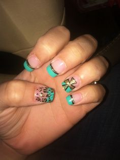 Turquoise nails with cheetah and cross design - I might change the colors up