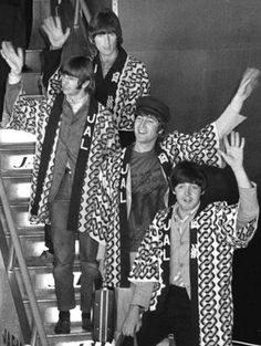The Beatles wave to fans upon arrival at Tokyo International Airport for their first concert in Japan on June 29, 1966