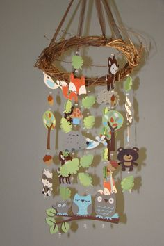 I really wish this wasn't so expensive.  This matches the decor in the nursery perfectly. Woodland Critter Forest Animal Baby Mobile. $75.00, via Etsy.