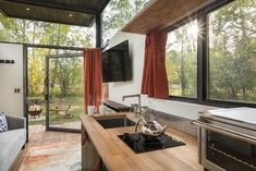 Tiny house from Wheelhaus is sleek and airy  - Curbedclockmenumore-arrownoyes : Windows all around