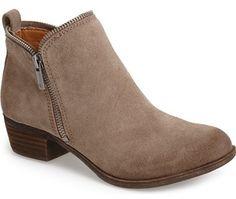 "Edgy zipper teeth trace the topline of a chic bootie boosted by a low, stacked heel. <ul> <li>1 1/2"" heel (size 8.5).</li> <li>4"" shaft height.</li> <li>Inside and outside side-zip closures.</li> <li>Leather upper/synthetic lining and sole.</li> <li>By Lucky Brand Dungarees; imported.</li> <li>BP. Shoes.</li> </ul>"