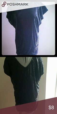 Black sequin tunic or dress. This can act as a shirt reversible neckline. Also if not too tall can fit as a mini dress. nikibiki Tops Tunics