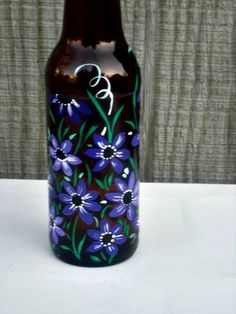 Dish soap dispenser made from a recycled brown beer bottle. This amber beer bottle has been made into a perfect dish soap dispenser, liquid soap for the bathroom, or can make a great oil and vinegar bottle.  Great size for those who dont want anything big on the sink. Hand painted with shades of purple flowers all around it.  Paint is a glass paint and has been heat set so its okay to hand wash. Comes with a easy pour spout, which works great with either diluted soap, which makes it last…
