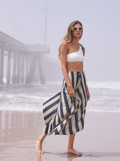 Full Stripe Pant   These dramatically wide and oversized cropped pants feature an asymmetrical hem and striped pattern. Semi-sheer and lightweight fabric with an elastic waistband and drawstring closure.