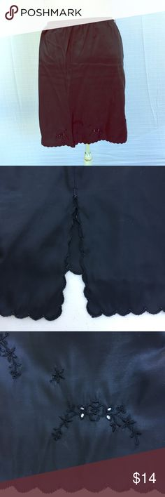 "Black Vintage half slip VINTAGE! Black nylon half slip. Elastic waist measures 11"" but stretches comfortably to 17"". It is 22"" long. Scalloped hem, some small monochromatic embroidery, and slit detail. Intimates & Sleepwear Chemises & Slips"