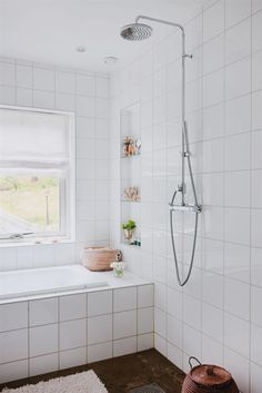One way to raise the shower head. Pipes on the outside of the wall.