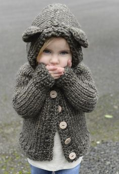 Knit this bear-y cute cardigan by The Velvet Acorn for your little one! Bladyn Bear Sweater pattern by Heidi May, made with Lion Brand Hometown USA and sizes 13 15 knitting needles. Find the pattern on Ravelry. Baby Knitting Patterns, Knitting For Kids, Knitting Projects, Sweater Patterns, Knitting Bear, Knitting Tutorials, Easy Knitting, Loom Knitting, Stitch Patterns