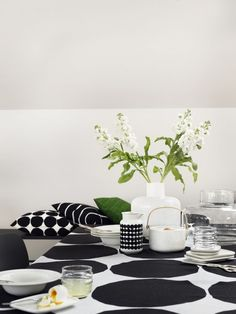 Marimekko Kivet White / Black Tablecloth Maija Isola's 1956 Kivet (Stones) pattern is set in it's classic black and white colorway atop a linen cloth. Perfect for use as a table linen but also suitable as a decorative bedding or wall tap. Marimekko, Scandinavian Design, Scandinavian Living, Black Tablecloth, Interior Decorating, Interior Design, Minimalist Interior, Rustic Feel, Home