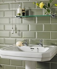 Metro Tiles in a neutral olive green colour for shower enclosure? Go with concrete style floor tiles? Topps Tiles 46p/tile