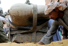 An Egyptian worker prepares the ground before the statue, that might be of revered Pharaoh Ramses II, who ruled Egypt over 3,000 years ago, is raised from the earth at the Matariya area, in Cairo, Egypt, March 13, 2017. REUTERS/Mohamed Abd El Ghany via @AOL_Lifestyle Read more: https://www.aol.com/article/news/2017/03/10/archaeologists-make-one-of-the-biggest-discoveries-ever-in-egypt/21879265/?a_dgi=aolshare_pinterest#fullscreen