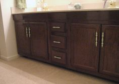 Restained cabinets makes a huge difference to a room