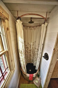 A cute shower in a barrel for a small space, i.e. a tack room.