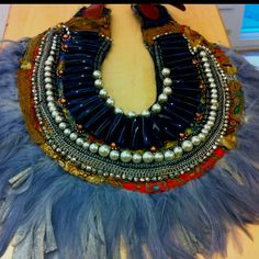 lay down some fabric then add beads and feathers... make a cute lil statement
