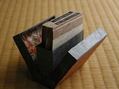 Magic Diary, designed and hand made by Miyako Akai. When you open the case, two books pop up. One covered with a Japanese paper with a leaf and inside yellow papers (Japanese dyed papers with onion), and the other vice versa. Covered with Japanese paper with a leaf, and Kozo papers used inside. Hand letterpress written in Japanese, bound with 3 colors strings. Calligraphied by Minoru Sasaki with many color-pencils. The size of the case is 3inch height. Only 3 copies.