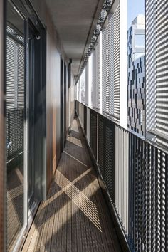 The outer skin of anodized, perforated aluminium, defines the rectangular Barcode body. Custom designed movable façade elements allow the occupants to control to which extent their apartment is exposed to sunlight and public surroundings.