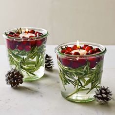 Festive idea for the Thanksgiving table. Fill glass jars with cranberries, rosemary, and a floating candle. #PANDORAloves #DIY