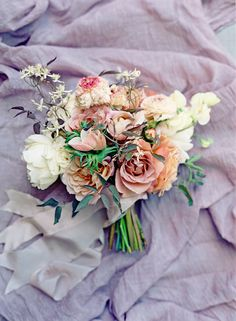 Embrace the increasingly-popular dusty-rose hue with muted blooms that set a romantic mood. Nicolette Camille designed this example.