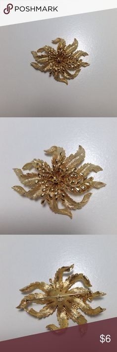 Unsigned Vintage Goldish Wilted Floral Leaf Brooch Beautiful gold tone Brooch. It measures approximately 2x2.5In.  He dented portion is a solid gold and the leaves are textured. It can be seen accenting another listing that is a Pink Worthington Jacket. Unsigned Jewelry Brooches