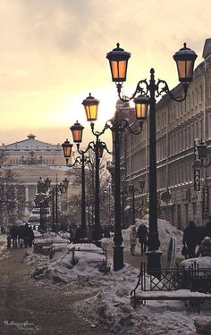 Winter street in St. Petersburg, Russia. Beautiful winter yellow sky.