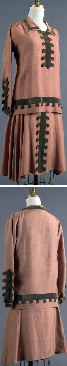1928 Two-piece sports dress, American: tan silk tweed trimmed with silk ribbon. Three-paneled skirt with flare is typical of later 1920s, and bias curve on sides left plenty of room for sports activities. During World War I, when wool and cotton were scarce, American silk manufacturers developed new silk and silk-blend fabrics to encourage women to wear silk around the clock. Via Smith College Historic Clothing.