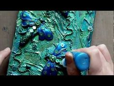 Mixed Media Art Canvas - Steampunk Dragonflies by RachO113. A timelapse video showing the creation of a canvas using mixed media art materials including polymer clay, moulds by After midnight, Acrylics, & Steampunk Clock parts. Fab!