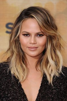 Chrissy Teigen. Teigen's auburn, caramel, and white-blonde highlights automatically give her waves a piece-y, defined feel.