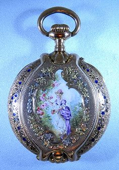 Oval Multi-Color Enamel: Fine and beautiful Swiss 18K multi-color gold and enamel oval ladies antique pendant watch with locket circa 1890. The case back with a painted enamel scene of a maiden in a garden within a border of applied flowers in various colors of gold. The case engraved overall enhanced by enamel foliage.