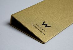 Gold fabric, lined with black Plike paper stock, with the logo foil blocked on the front covers.