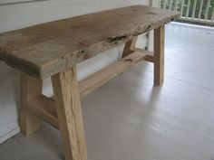 This unique rustic bench is made out of antique reclaimed barn wood from Pennsylvania. The natural beauty of the wood has been preserved, as it is only lightly sanded and finished with a clear sealant. This bench makes the perfect addition to your po