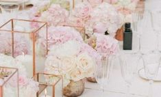 There's nothing that brings femininity to a reception table more than a floral blush pink centerpiece.
