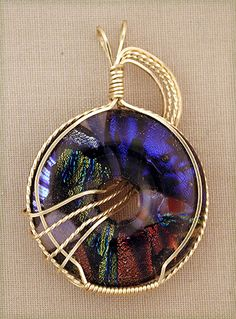 A dichroic glass cabochon I made several years ago that was wire wrapped