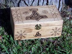 "This gorgeous box is the perfect place to store sacred items and a perfect gift for those of the Asatru faith. On the top is an ornately-burned Thor's Hammer ""Mjolnir"". The symbol many of the faith us"
