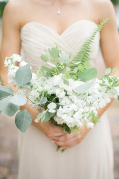 Each carried a bouquet of ranunculuses, stock, Queen Anne's lace, silver dollar eucalyptus, and fern leaves.