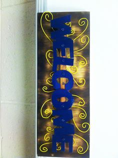 An FFA welcome sign created during my fabrication class with a friend. Used a plasma cutter on 1/8 in metal for letters, oxy acetylene welding rods for spirals, and a wooden backboard with a torched effect.