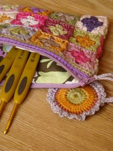 Crochet hook bag made of little granny squares-15 per side, 30 total, DMC linen thread with a 2.5 mm/B hook (US), with crochet around the top, lined witha  zipper and a crochet zipper pull attached