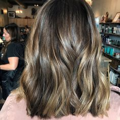 @slh_hair on Instagram: Alternate view of this babylight & balayage application. We kept her front heavy and saturated to create boldness around her face. And distributed dimension through the back to keep her color balanced throughout her cut.⠀Previous pic says: Lowlighted with a 4.3 from roots to midshaft to create depth at her base, that allows a graceful grow out. We also balayaged to brighten up around her face & throughout the hair to create more contrasts. Toned with 9NW/9P