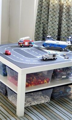 Use IKEA's LACK Coffee Table to make a LEGO command center, complete with bins organized by color and a street on top.