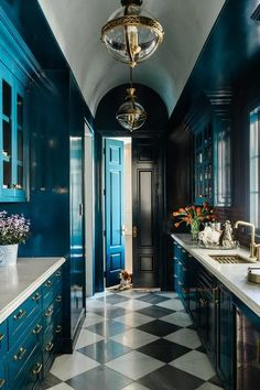 Crown Top Banded Globe Lanterns illuminate a long blue galley style butlers pantry with a barrel ceiling. Crown Top Banded Globe Lanterns illuminate a long blue galley style butlers pantry with a barrel ceiling.