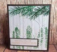 Used Stampin Up embossing woodland folder, and branch dies. Inked folder before embossing.