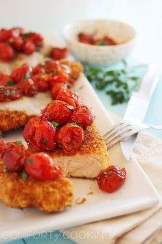 Crispy Parmesan Chicken with Balsamic Roasted Tomatoes. Cherry tomatoes (cooked in a tasty marinade of garlic, balsamic vinegar and olive oil) top crispy chicken cutlets & are garnished with fresh parsley in this yummy recipe. | The Micro Gardener