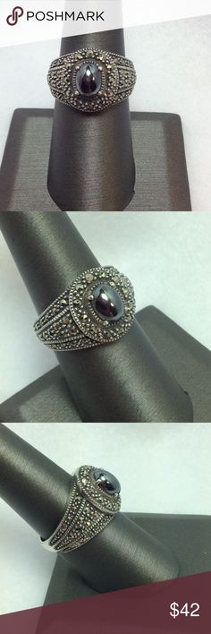 Sterling Hematite & Marcasite Signet Ring - Size 8 Beautiful Sterling signet/cigar style band ring!  Ring is heavily laden with faceted marcasite stones which surround an oval Hematite cabochon stone in the middle of the ring.  Sophisticated styling with a gleaming gunmetal color that will look great with all your fashions!  Excellent used condition.  Size 8. Unlisted Jewelry Rings