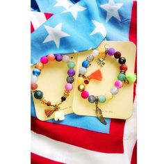 NEW ARRIVALS: Merica bandana headband + multi colored tassel bracelets #memorialday #tassels #neon