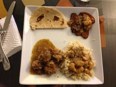 Jamaican style veal-tail, brown rice, fried plantain and homemade naan