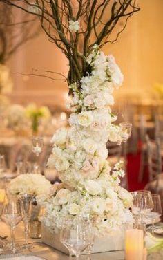rustic white flowers tall wedding reception centerpiece idea via john cain photography