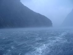 Watching a southern storm roll in on an Doubtful Sound Overnight Cruise - great shot from Andrei Alb-albastru