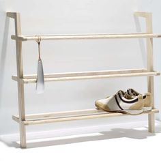 Single image of the Shoe Cabinet Gaston with Shoehorn by side by side. The shoe cabinet provides space for ca. 9 pairs of men's shoes or 12 pairs or women's shoes and consists of untreated massive ash wood. Small Furniture, Furniture Design, Shoe Storage Solutions, Entryway Shoe Storage, Shoe Shelf Diy, Regal Design, Shoe Horn, Rack Design, Shoe Cabinet
