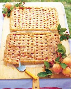 Peach-Raspberry Slab Pie - This great big pie, baked in a jelly-roll pan, serves 16 people. Make the decorative top crust on this juicy peach and raspberry pie by cutting out holes using a 1/2-inch round pastry tip.