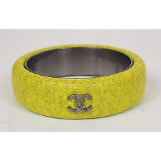 Pre-owned Chanel Cc Logo Fluorescent Yellow Coated Fabric Bangle... ($300) ❤ liked on Polyvore featuring jewelry, bracelets, accessories, yellow, yellow bangle bracelet, neon yellow jewelry, chanel, bracelets bangle and hinged bracelet