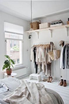 Ideas & Inspiration: Storing Clothes in Apartments with No Closets. Considering to use curtains to hide my closet behind the bed.