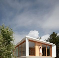 This prefabricated house in Portugal costs about the same price to manufacture as a family car (photographs by José Campos). Designed by Mima Architects, the Mima House has a modular structure and can be divided into rooms with a grid of removable partiti Mima House, Tyni House, House Front, Prefabricated Houses, Prefab Homes, Modular Homes, Cabinet D Architecture, Interior Architecture, Dezeen Architecture